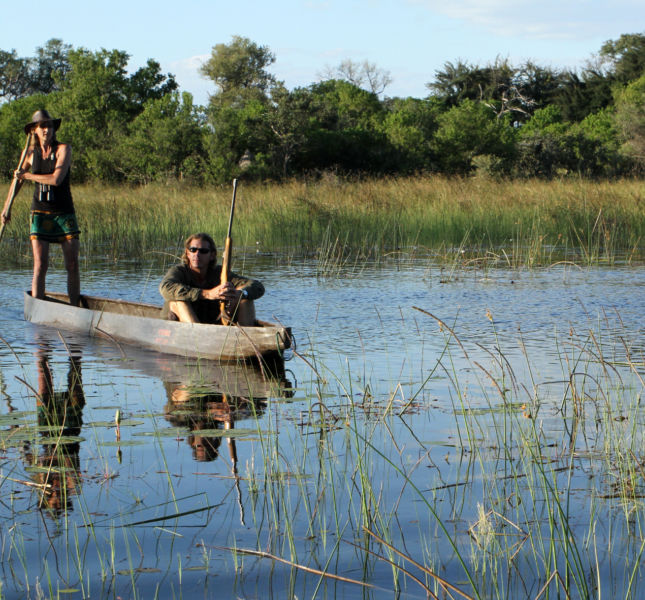 Poling Mokoros Dug Out Canoe In The Delta